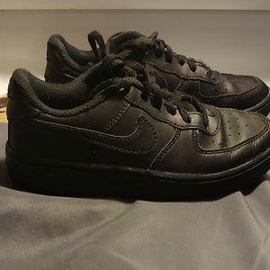 Kids black Air Force 1 Nike shoes
